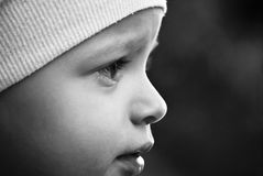 The look of a child. Little child glancing at the world aorund Royalty Free Stock Image