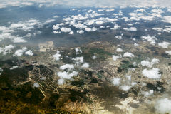 Look at the clouds and the Earth from a height of ten thousand f Stock Image