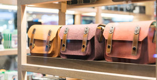A look through colorful fabric handbag in wood shelf stock photography