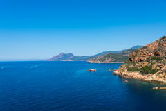 Look at the Corsica sea. Corsica sea and beach rith rocks stock photography