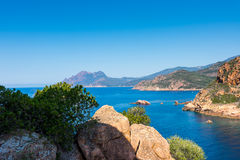 Look at the Corsica sea. Corsica sea and beach rith rocks stock photos