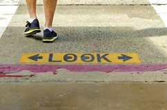 Look crossing sign Stock Photo