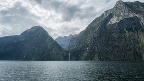 Milford Sound Cliff Wall. Look at the damage left over from the glaciers thousands of years ago stock photo
