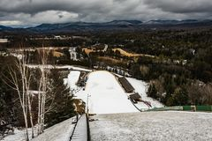 Look Down from Ski Jump. Lake Placid, New York / USA/ Feb. 21, 2016: Visitors can ride elevator to top of ski jump towers at the Lake Placid Olympic Ski Jumping Stock Photos