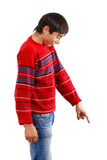 Look down there. Man in red pullover showing down isolated on white background Royalty Free Stock Photo