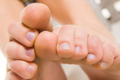 Look at feet. Pretty woman  legs macro over white Royalty Free Stock Image