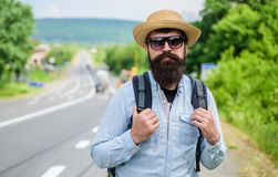 Look for fellow travelers. Tips of experienced backpacker. Man bearded hipster backpacker at edge of highway. Pick me up royalty free stock images