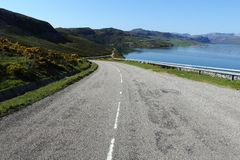 Look forward to your future. Simple coastal road to in the Scottish Highlands Royalty Free Stock Photography