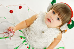 Look of girl in festive attire. Little girl in festive attire on white background Stock Photos