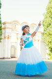Look! Girl in a magnificent gala dress shows thumb up Royalty Free Stock Image