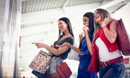 Look this girls. Shopping time. royalty free stock images
