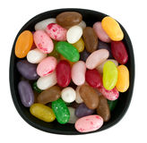 Bowl of bright jellybean sweets, confectionary - isolated over w Stock Photo