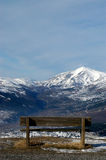 A look at the Gran Sasso - Abruzzo - Italy. A bench that allows a panoramic view on the Alps Abruzzo Gran Sasso royalty free stock images