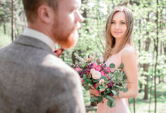 Look from groom& x27;s shoulder at stunning brown-haired bride stock images