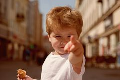 Look at that haircut. Small child point finger on street. Little boy with stylish haircut. Little child with short blond. Hair. Hair care products. Healthy hair royalty free stock photo