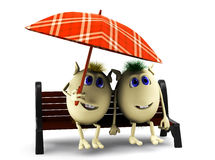 Look on happy  puppets under  checkered umbrella Stock Photo