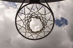 Look at the heaven through a basketball hoop. Stock Images
