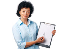 Look Here. Elder woman holding a clipboard and showing something over white Royalty Free Stock Images