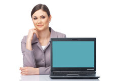 Look Here, Please. Young businesswoman presenting at the laptop over white Royalty Free Stock Photography