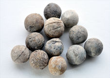 Look at historic musket balls into. Detailed view of the historic musket balls into Royalty Free Stock Photo