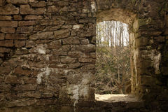 A Look Through History. The remains of an old Woollen Mill with a doorway looking into the distant scenery Royalty Free Stock Images