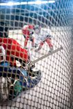 Look through the hockey goals. Look through the net hockey goals stock photography
