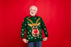 Free Look I Got Wonderful Present. Portrait Of Positive Cheerful Funky Old Man Show His Theme Christmas Party Sweater Deer Royalty Free Stock Photo - 160286145