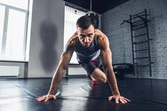 The athlete trains hard in the gym. Fitness and healthy life concept. royalty free stock image