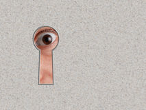 Look through a keyhole in stone wall Royalty Free Stock Photo