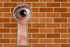 Look through a keyhole in stone wall Stock Image