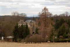 Look at the landscape of the village and the church in the Czech Republic. Captured in spring stock photo
