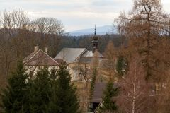 Look at the landscape of the village and the church in the Czech Republic. Traditional countryside cottage stock images