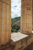 Look at largentiere through the pillars of the neoclassical cour Royalty Free Stock Images