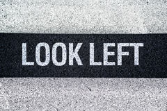 Look left on Pedestrian crossing Stock Image