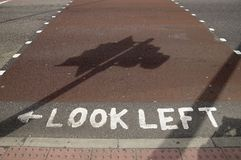 Look left sign on the road Stock Photo