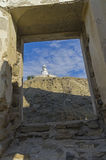 A look at the lighthouse from the window of a ruined house Stock Photos