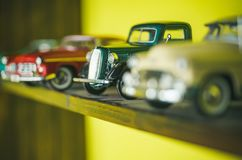 They look like real cars. Classic model vehicles or toy vehicles. Miniature collection of automobiles. Retro car models. On shelf. Retro styled cars. Toy cars royalty free stock photo