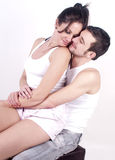 Look of love. Woman sat on mans lap looking into his eyes Royalty Free Stock Images
