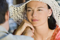 Look of Love. A beautiful young woman looking lovingly across a table at her man Royalty Free Stock Photo