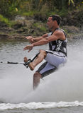 Look Ma - No Hands!. MW World Champion Barefoot Water Skier, Andre de Villiers (RSA)  rope on foot  one foot forwards in the tricks event Stock Photo