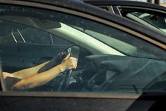 A woman with her hands on the steering wheel ready to drive. royalty free stock image