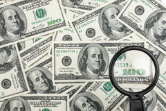 Look through a magnifying glass on the money Royalty Free Stock Photography