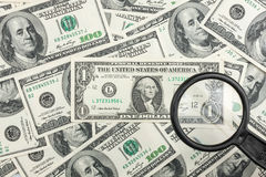 Look through a magnifying glass on the money Royalty Free Stock Photo