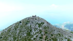 Look at Makarska from the top of the mountains in the clouds stock video footage