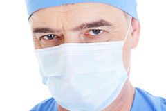 Look mature male surgeon in medical mask Royalty Free Stock Image