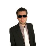 Look at me. Business man wearing sunglasses looking at the camera isolated over white background royalty free stock photography