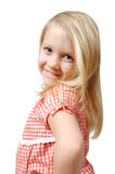 Look at me!. Cute little blond girl bites her lower lip and smiles at the camera. Lots of perosonality and sneakieness! Trouble or Innocent? Happy smiling child Stock Photos