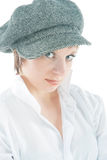 Look into my eyes. Caucasian sensual young girl with passion look wearing grey cap standing over pure white background Stock Image