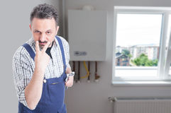 Look into my eyes concept with male plumber Royalty Free Stock Photos