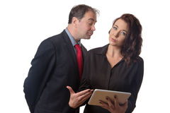 Look at my face not my breast. Business men looking at a female work colleague boobs royalty free stock photo